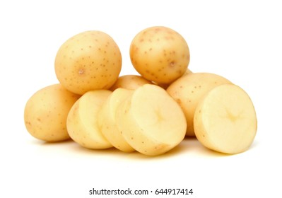 Close up of stack yellow potatoes against white background.