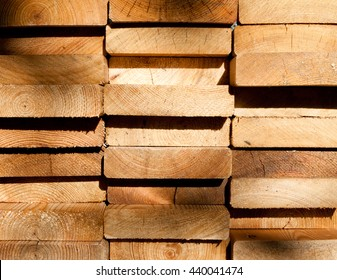 Close up of stacked larch planks seen from the end