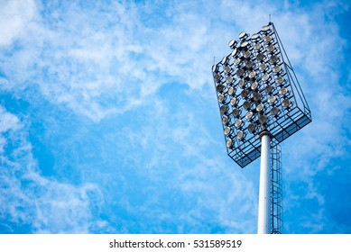 Close up of stadium lights with blue sky background