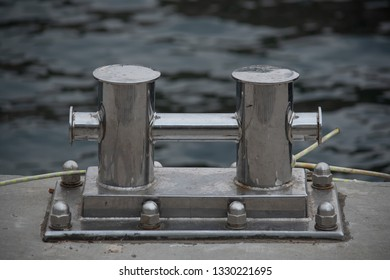Close up stainless steel bollard or bitts in the dock