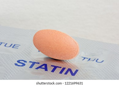 Close up of a Statin Tablet on a Blister Pack. Medication and Health concept
