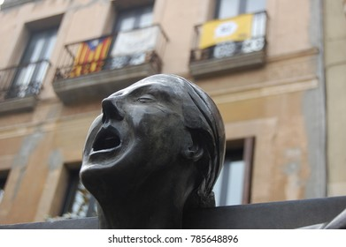 Close up of statue in Catalunya with independence flags in the background