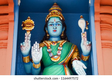 Close up of statue of Hindu deity at Sri Mariamman Hindu Temple in Singapore