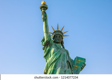 Close up of Statue of Liberty, iconic landmarks of Odaiba Island in Tokyo, Japan in the blue sky. Replica of famous Statue of Liberty of New York City.