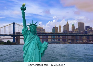 Close up of the Statue of Liberty on clouds sky, New York City background,