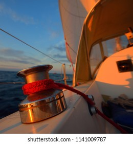 Close up of a staysail winch on a yacht sailing in a open sea on an evening in Baltcis
