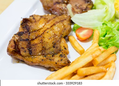 close up of steak dinner with french fries and salad.