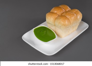 Close up of steamed bread and pandan custard, Thai dessert, Pandan Custard Bread, Soft bread home made, on grey background.