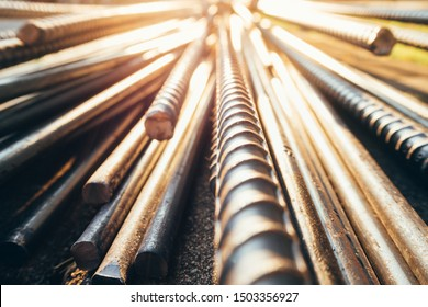 close up steel bar or steel reinforcement bar in the construction site with sunbeam at the morning, steel rods bars can use for reinforce concrete.