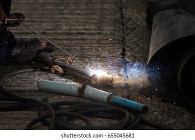 close up steel  welding with fire from gas without protect body