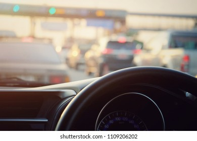 close up steering wheel with blurred traffic jam background, vintage tone