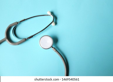 close up stethoscope of black color on blue background.