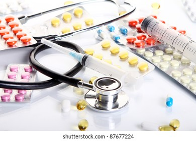 Close up of stethoscope with different pharmaceutical stuff