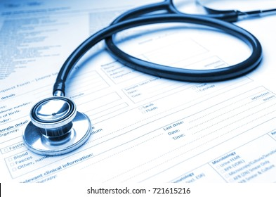 close up stethoscope and medical information form on desk, healthcare technology, medical research diagnosis, medical report record and history patient concept, selective focus, blue color tone