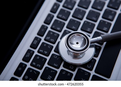 close up of stethoscope on the keyboard