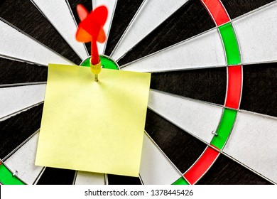 Close up sticky notes on dart board.Note paper for write something.Business target or goal success and winner the marketing concept.free space.