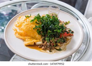 Close up stir fried minced pork with basil and fried egg