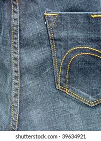 Close up of stitching on jean trousers
