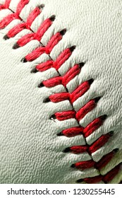 A close up of the stitching on an offical Major League baseball.