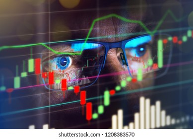 Close up of stock market trader looking at graph of share prices