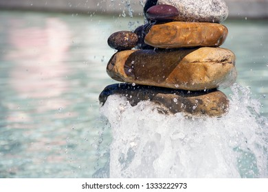 close up of a stone cairn in water fountain