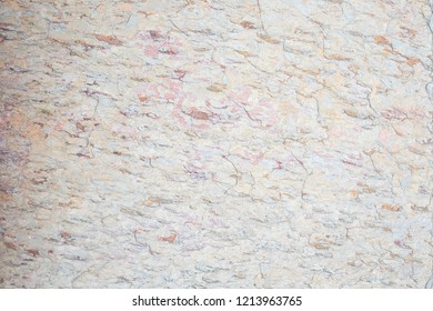 Close up of a stone surface.