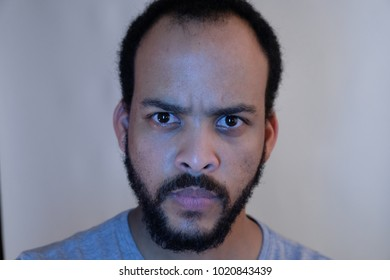 Close up straight face of bearded man