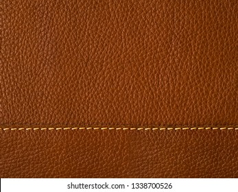 Close Up straight seam on surface of natural brown leather.