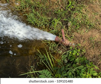 Close the stream of water flowing out of PVC pipe to feed the grain in order to grow and harvest