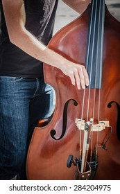 Close up of a  Street musician playing double bass