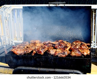 Close up of a street vendor's barbeque chicken on the grill.