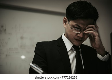 Close up stress Asian businessman,Fail from work,Thailand people,Not success from business,Sadness man concept