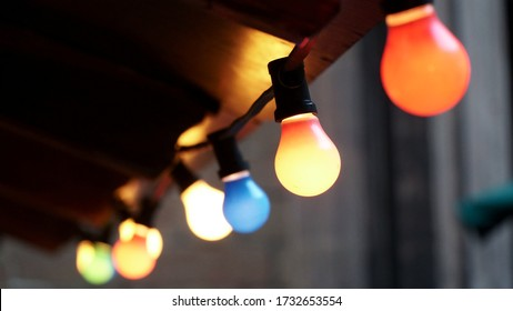 Close up of string of colored light bulbs decoration