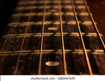 Close up strings of old acoustic guitar