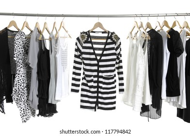 close up of a in stripy shirt and Fashion female clothing hanging on hangers