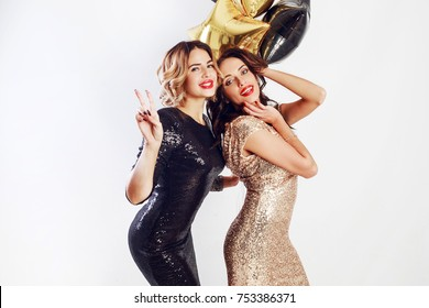 Close up studio image of two amazing sexy celebrating woman with red lips, send kiss, laughing , posing on white background.