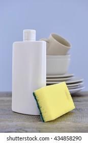 A close up studio photo of dishwashing detergent