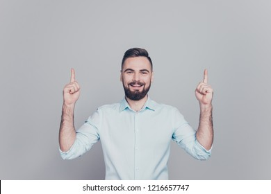 Close up studio photo portrait of cheerful glad candid content ceo marketer human choosing making choice showing direction way over head overhead with forefinger isolated grey background copy space