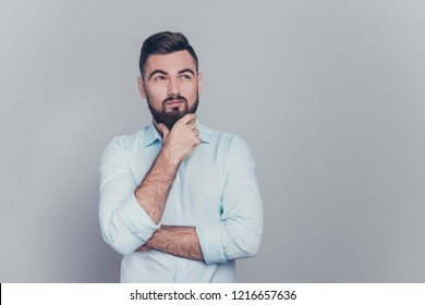 Close up studio photo portrait of clueless puzzled confused uncertain unknown indifferent maybe shrugging brunet human looking up at solution problem issue answer isolated on grey background