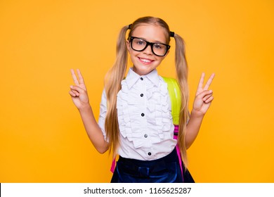 Close up studio photo portrait of lovely nice beautiful cheerful rejoicing sweet little small lady showing making giving v-sign in white shirt blouse formal wear isolated bright vivid background