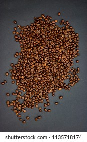 A close up studio photo of roasted coffee beans