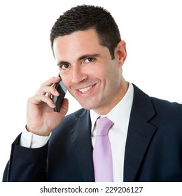 Close up studio Portrait of Attractive businessman in suit talking on smart phone.Isolated on white background.