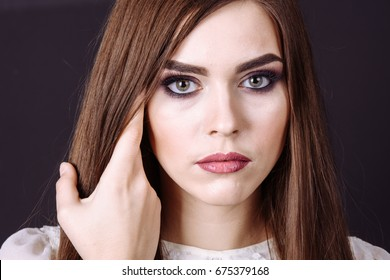 close up Studio portrait of a beautiful young woman with brown hair. Pretty model girl with perfect fresh clean skin. Beauty and skin care concept