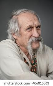 close up studio portrait of old man in the ethnic ukrainian national costume