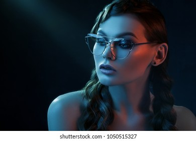 7c97e21d211 Close up studio portrait of young beautiful sexy woman wearing stylish  transparent glasses with metallic frame