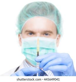 Close up studio shot of medical doctor holding syringe in hands