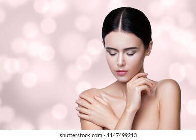 Close up studio shot, portrait of a beautiful young brunette girl face care. Copy save. girl with closed eyes. healthy fresh skin, touching your face.