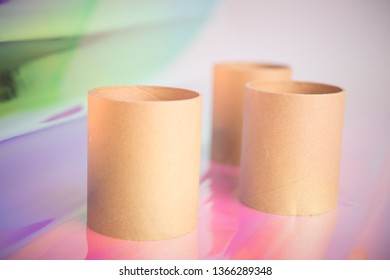 Close up studio shot of three toilet paper rolls on dazzle-bright laser background, and this can be used as DIY materials background