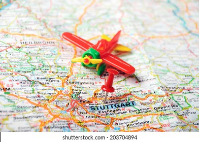 0929eea03b Close up of Stuttgart map with red pin and airplane - Travel concept