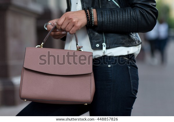 Close up of stylish female leather bag outdoors. Fashionable and high style expensive female bag. Sales bag fashion concept